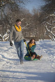 Young lovers having fun in winter clothes in the Park. Elegant w Stock Images