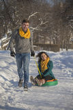 Young lovers having fun in winter clothes in the Park. Elegant w Royalty Free Stock Photo