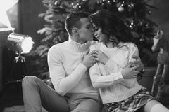 Young lovers at home on christmas evening Stock Photo