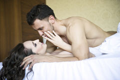 Young lovers lay in bed Stock Image