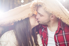 Young lovers man and the woman hid under a soft blanket. Young lovers men and the women hid under a soft blanket from bright light. These people love each other royalty free stock photography
