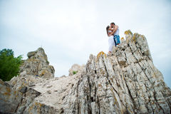 Young lovers man and woman walking in the mountains Stock Photos