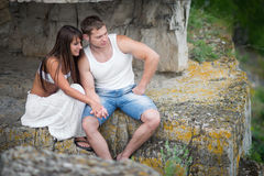 Young lovers man and woman walking in the mountains Stock Photography
