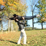 Young lovers. Young men holding a girl jumping like in movie Dirty dancing Stock Image