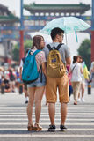 Young lovers with a parasol, Beijing, China Royalty Free Stock Image