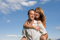 Young lovers piggy back Stock Photo