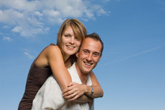 Young lovers piggy back Royalty Free Stock Photos