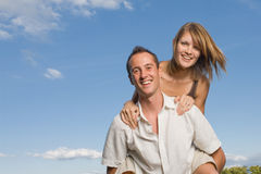 Young lovers piggy back Stock Photography