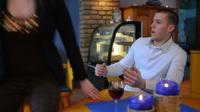 Young lovers quarrel in the restaurant stock video