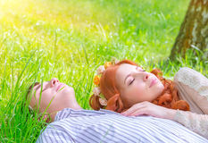 Young lovers resting outdoors Royalty Free Stock Photos