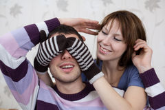 Young lovers in the room. Attractive couple posing on background of wall Stock Image