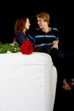 Young lovers with rose Stock Photography