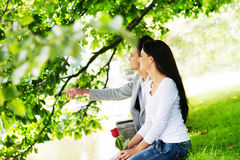 Young lovers sitting on the lake side Royalty Free Stock Photography