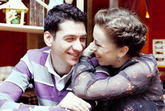 Young Smiling Couple in Cafe Stock Photos