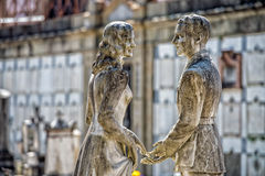 Young lovers while smiling marble statue Royalty Free Stock Photo