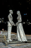 Young lovers while smiling marble statue Royalty Free Stock Photos