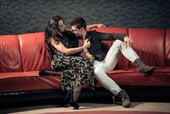 Young lovers on a sofa Royalty Free Stock Photography