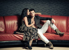 Young lovers on a sofa Stock Photography
