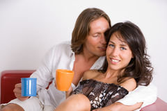 Young lovers on the sofa Stock Image