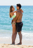 Young lovers standing on sandy beach Stock Photography