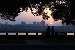 Young lovers under setting sun. To the side of xiangjiang river in changsha Royalty Free Stock Photo