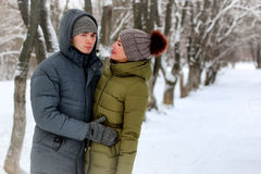 Young lovers walk smile. Winter Royalty Free Stock Photography