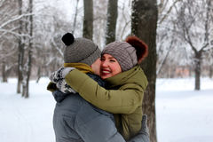 Young lovers walk smile winter Stock Photo
