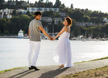 Young Lovers walking towards the Water Stock Photos