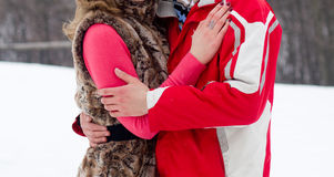 Young lovers woman and man in winter park Royalty Free Stock Photos
