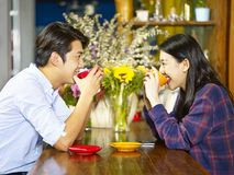 Loving young asian couple in coffee shop Royalty Free Stock Images