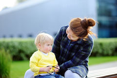 Young loving asian woman with cute caucasian toddler boy Stock Images