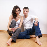 A young loving Caucasian couple in stylish jeans Stock Image