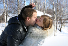 Young loving couple on a nature, kiss Stock Photos