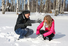 Young loving couple playing with snow Stock Images
