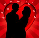 Young loving couple on a background a heart Royalty Free Stock Photos