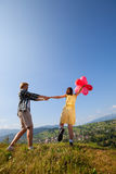 Young loving couple with balloons. On countryside background stock photo