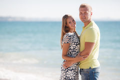 Young loving couple on the beach near the sea Stock Images
