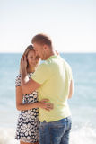 Young loving couple on the beach near the sea Royalty Free Stock Photography