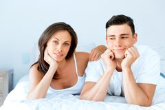 Young couple in the bed. Young loving couple in the bed Royalty Free Stock Images