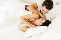 Couple in bed. Young loving couple in the bed Stock Images