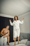 Young loving couple in the bed stock images