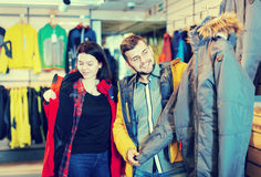 Young loving couple buying windcheater in store Royalty Free Stock Photography