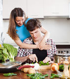 Young loving couple cooking with  vegetables Stock Images