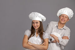Young loving couple cooks. Stock Photos