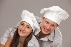 Young loving couple cooks. Stock Photo