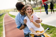 Young loving couple dating while riding bicycles in the city. Young beautiful couple dating while riding bicycles in the city Stock Image