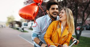 Young loving couple dating while riding bicycles in the city. Young beautiful couple dating while riding bicycles in the city Royalty Free Stock Image