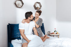 Young loving couple embrace in bed Stock Photo