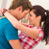 Young Loving Couple Embracing And Smiling Romance Stock Image