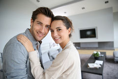 Young loving couple embracing at home Stock Image